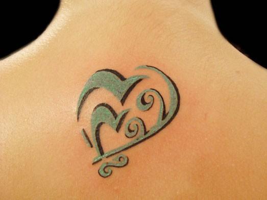 Что означает татуировка сердце в руке